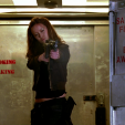 Summer Glau as Cameron shoot at a terminator