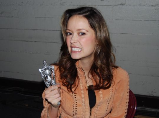 Summer Glau holding a Terminator doll at the Comic Book and Science Fiction convention