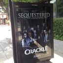 Sequestered bus stop ad